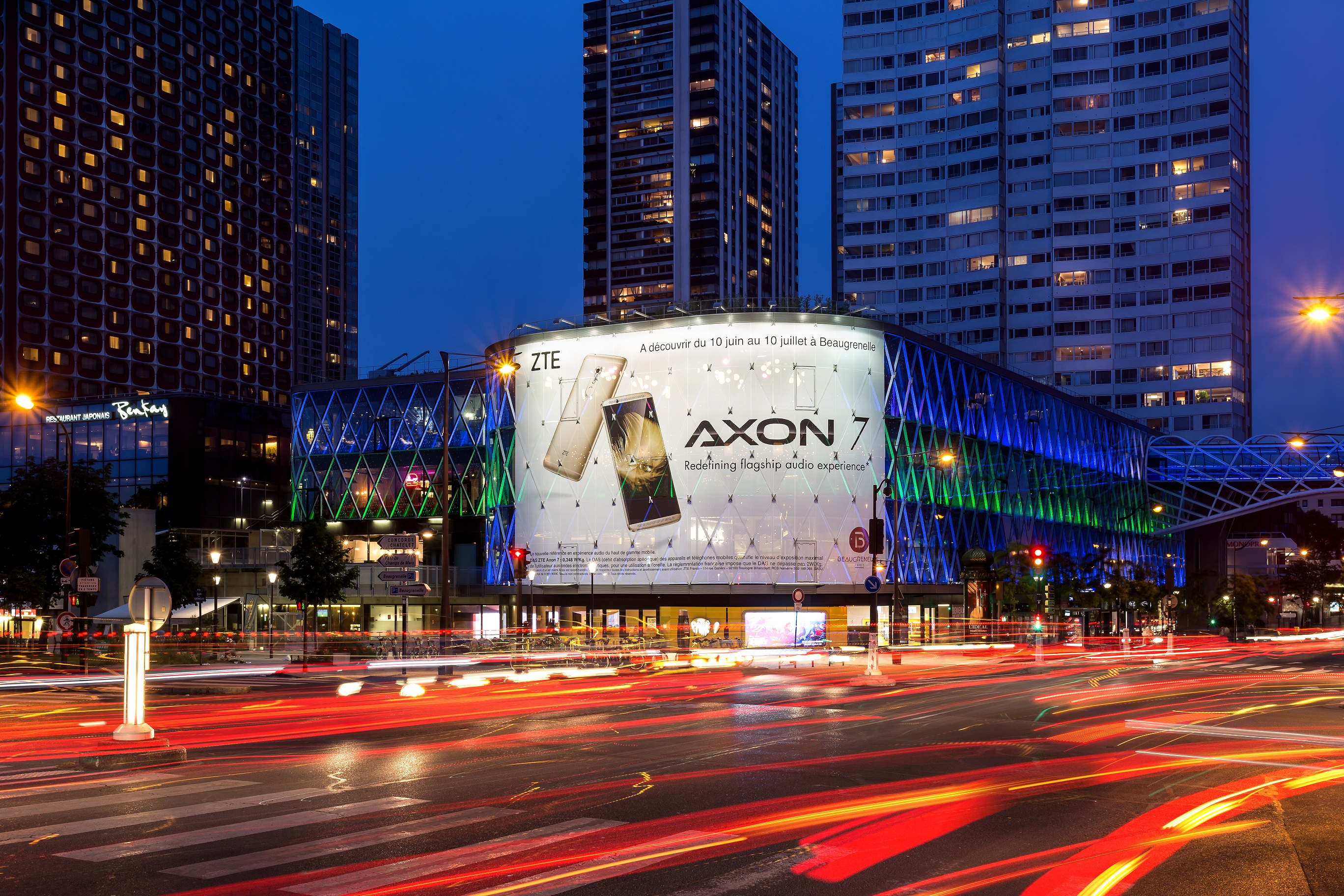 A ZTE AXON 7 advertisement adorns an ultra-modern building in Paris